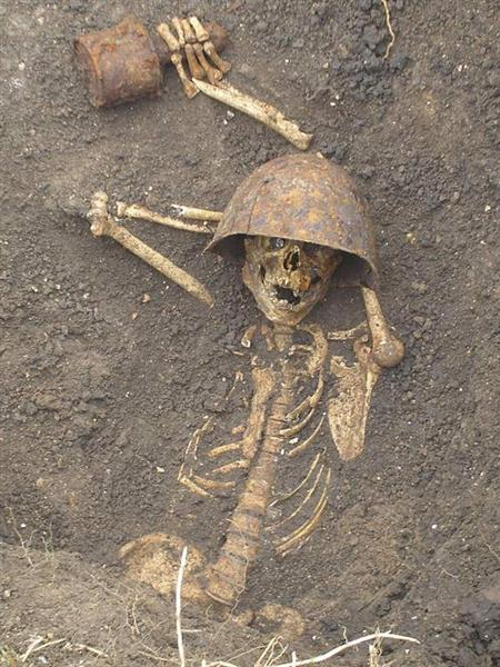 Skeleton Holding Grenade - Click To View Image